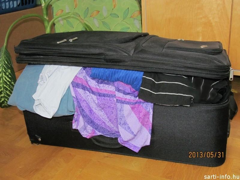 Tele a bőrönd