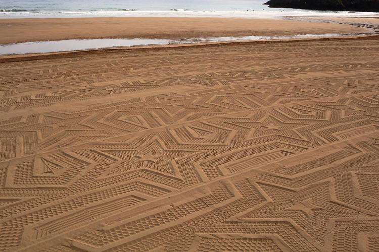 Csillagmintás homok a tengerparton (Laga Beach, spanyol tengerpart)